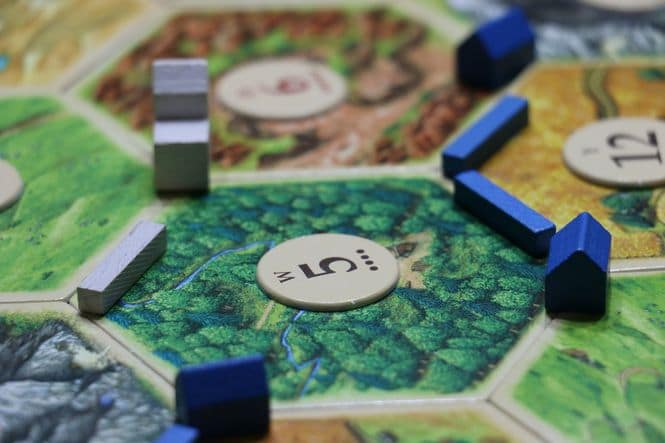 Close up photo of a board game with game pieces.