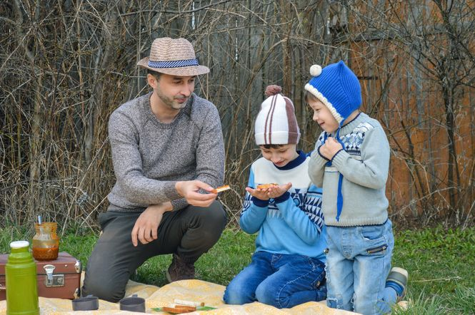 A family having a picnic outside.