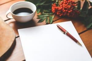 A cup of coffee along with a paper and pen to write a letter to your spouse.