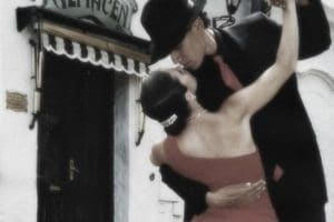 A man and woman romantically embraced while dancing the tango.