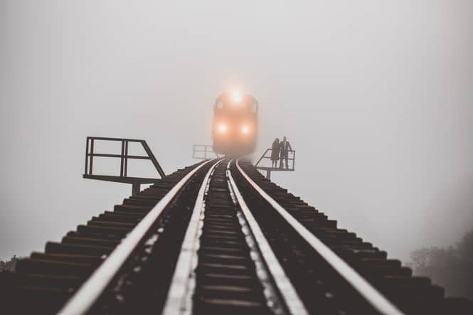 Picture of a train chugging up the tracks in the fog to symbolize the debt train coming after you.