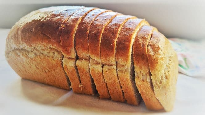 A photo showing a sliced loaf of easy homemade bread.