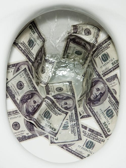 An image showing hundred dollar bills being flushed down a toilet.