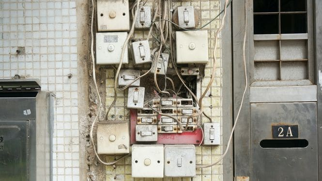 An image showing a lot of light switches wired together.