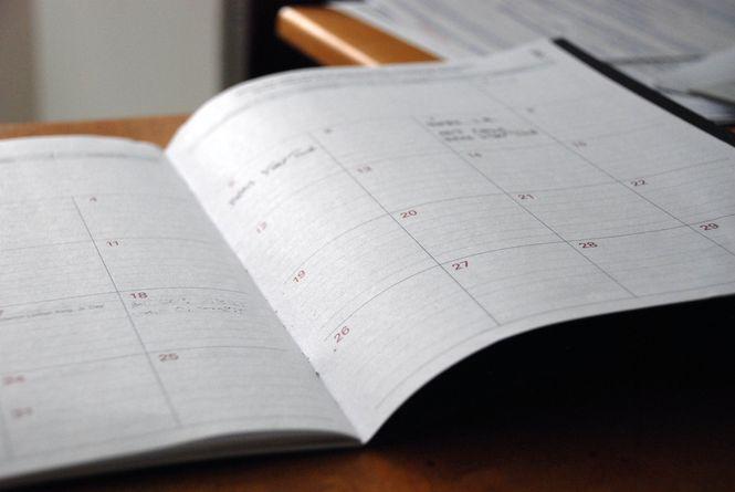 A calendar book lying open on a table.