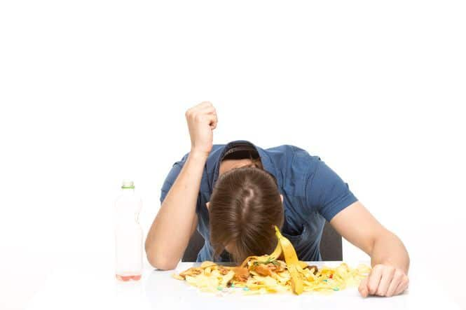 Young teenager eating a lot of food. Save money as a stay at home mom by optimizing your meals.