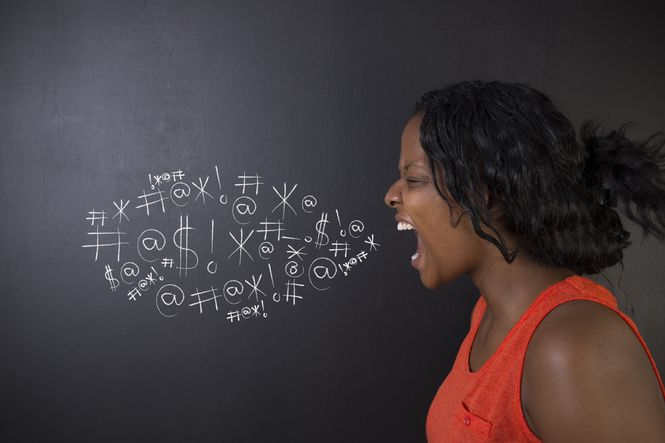 A woman yelling with #*$&% shown on a chalkboard behind her showing swearing in an argument is one of her toxic marriage habits.