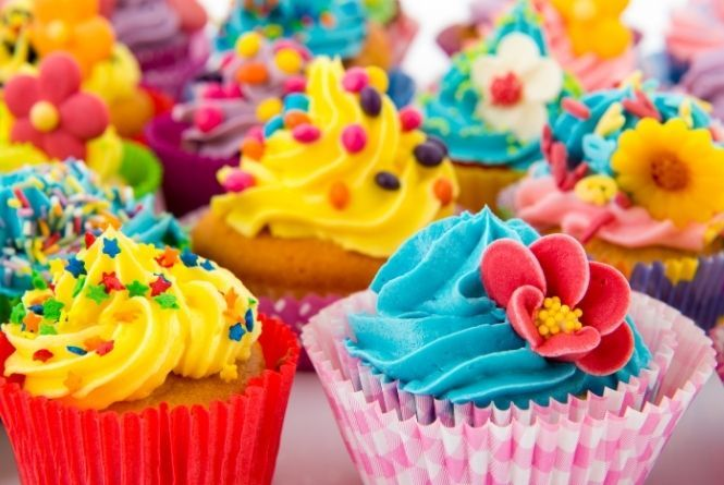 Make a child feel special on their birthday by sending treats to school. This is a picture of a bunch of colorful cupcakes.