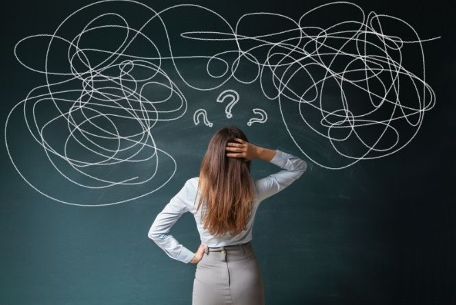What is pregnancy shaming? This is a picture of a woman looking at a board with a bunch of confusing scribbles.
