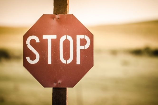 When young siblings fight in public make them stop immediately. This is a picture of a red stop sign.
