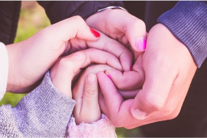 Growing your family does not have to be troublesome. This is a picture showing a bunch of siblings holding hands.