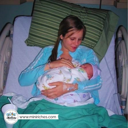 Growing your family will change your life. In this image is Angela of Mini Riches holding our first son.